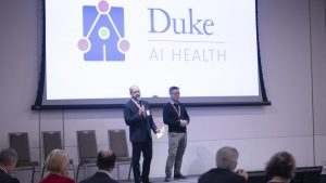 Photograph of AI Health Co-Director Lawrence Carin, PhD, and Duke Forge and Duke Crucible Director Erich Huang, MD, PhD, introduce Duke AI Health at the Fall 2019 Duke Health Data Science Showcase.
