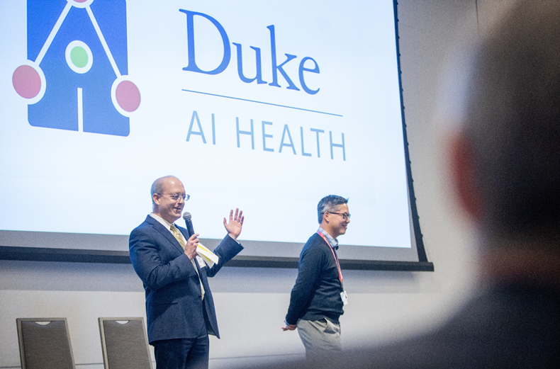 Duke AI Health Co-Director Lawrence Carin, PhD and Duke Forge Director Erich Huang, MD, PhD describe Duke AI Health to an audience at the 2019 Duke Health Data Science Fall Showcase.