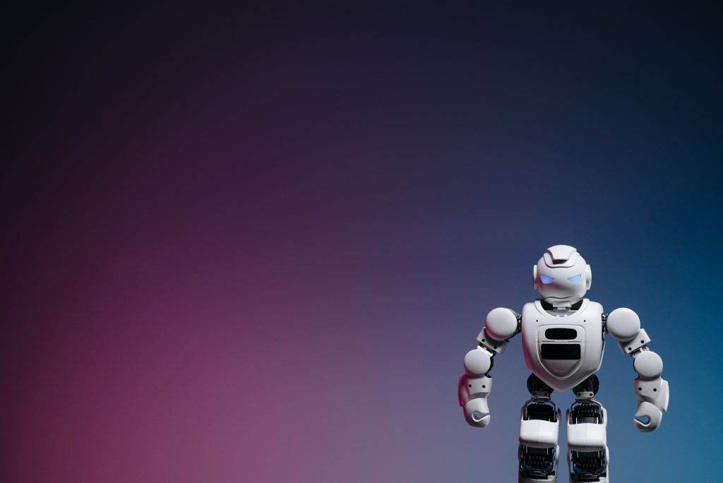 Image of a robot against a purple and green background